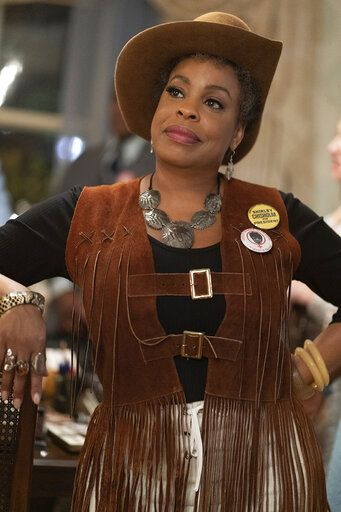 "This image released by FX shows Niecy Nash as Florynce ""Flo"" Kennedy from the miniseries ""Mrs. America,"" an FX original series premiering April 15 on Hulu. (Sabrina Lantos/FX via AP)"