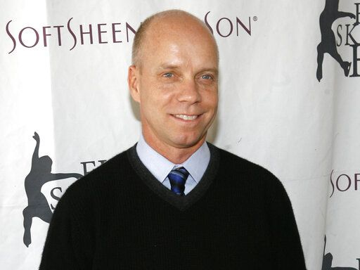 "FILE - In this April 9, 2007, file photo, Olympic figure skating gold medalist Scott Hamilton arrives for Figure Skating In Harlem's annual gala ""Skating with the Stars"" at Central Park's Wollman Rink in New York. Despite having no ice on which to perform, more than 40 figure skaters from nine countries will take part in a fundraiser Friday, April 17, 2020, to help healthcare workers on the front lines battling the new coronavirus. Such Olympic and world champions as Hamilton, Michelle Kwan, Brian Boitano, Kurt Browning, Ekaterina Gordeeva and Evgeni Plushenko have compiled videos as part of the one-hour event 'œBlades for the Brave.'�"