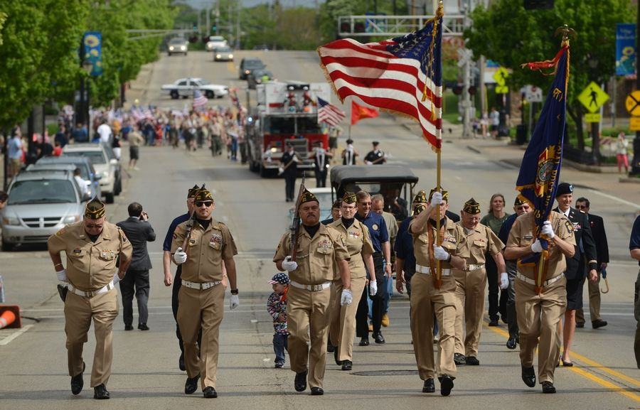 The Libertyville VFW and American Legion color guard lead the Memorial Day parade in downtown Libertyville.