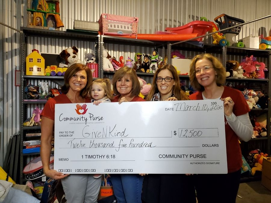 Representatives of Community Purse Lake County give a grant to GiveNKind. From left, Sue Voorhees, Amy Kamins, Emily Petway and Carolyn Dun.