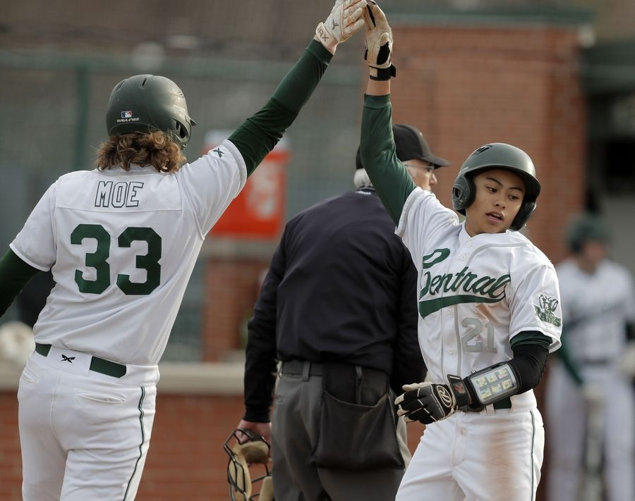 Grayslake Central's Marcus Maristela, right high-fives teammate Coby Moe during a game last spring.