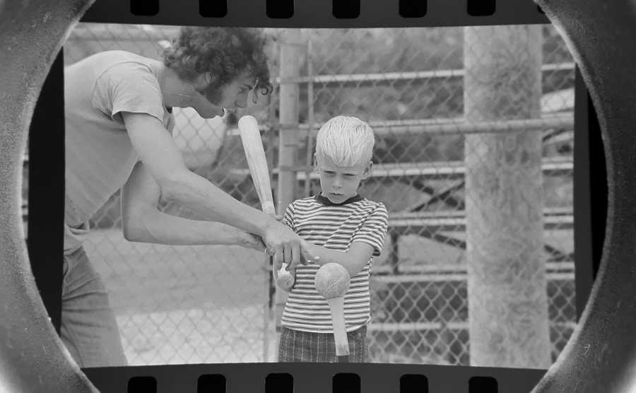 The Daily Herald Archives, Assignment # 29,663, Jim Frost photo: This youngster gets some guidance on hitting the ball during a Pee Wee softball game in Prospect Heights in August of 1973.