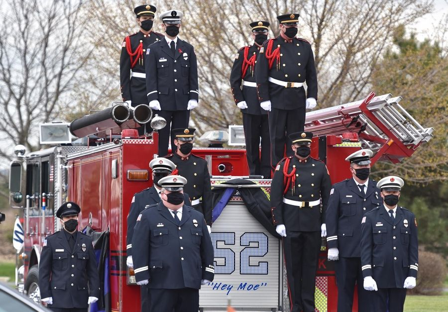 Firefighters wait to lift the casket at the funeral for Lincolnshire-Riverwoods firefighter/paramedic Mark Amore at Church of Holy Apostles in McHenry Wednesday.