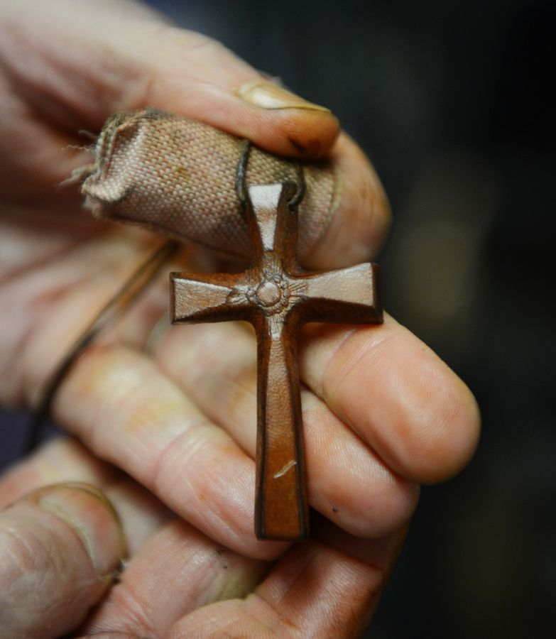 Larry D'Angelo, owner of Al's Shoe Service in Mount Prospect, is making crosses by hand from leather and rubber, and he now has thousands of orders from all over the country. The idea originated after business declined at his shop due to the COVID-19 stay-at-home order.