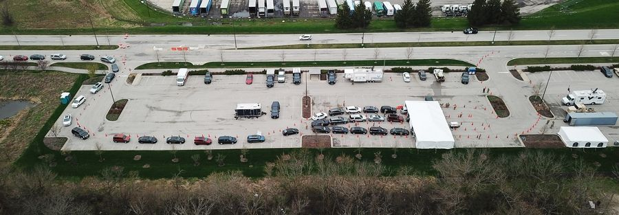 Drive-up testing for COVID-19 is taking place in a parking area near the Chicago Premium Outlets mall in Aurora Thursday.