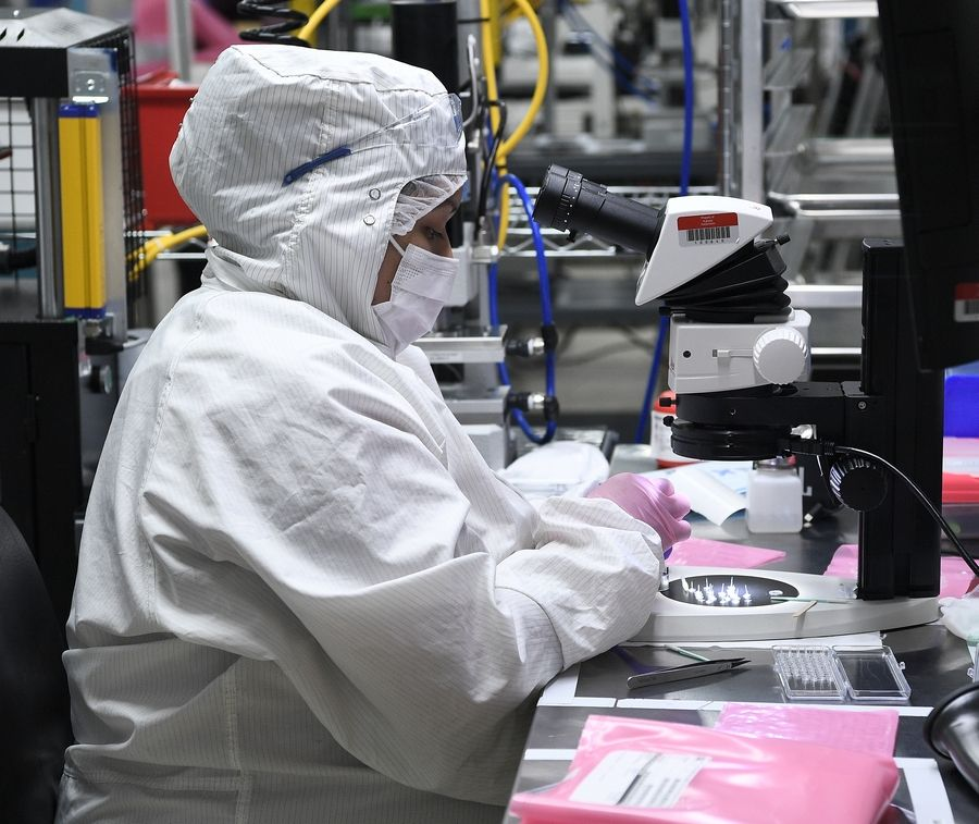 A worker in the clean room at Flexan in Lincolnshire where production of medical devices to help meet the needs during the coronavirus pandemic are being ramped up.