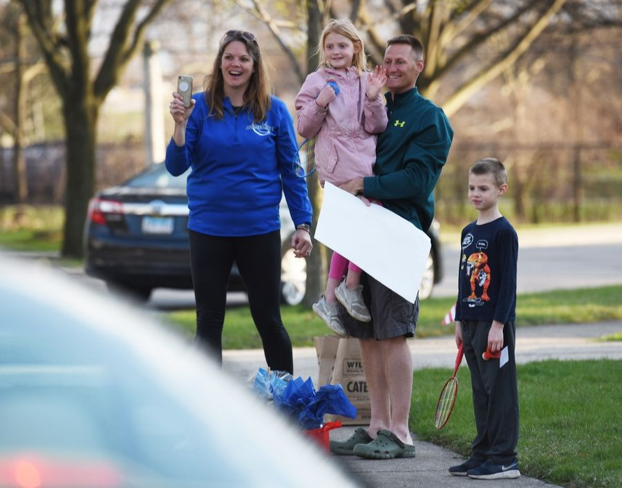 Illinois Army National Guard member Staff Sgt. Eric Gutzmer got a welcome home drive-by parade Monday at his Palatine home. Gutzmer was joined by his wife, Abbie, and children Ellie and Will. Sgt. Gutzmer returned home Sunday after being deployed on a mission in Afghanistan.