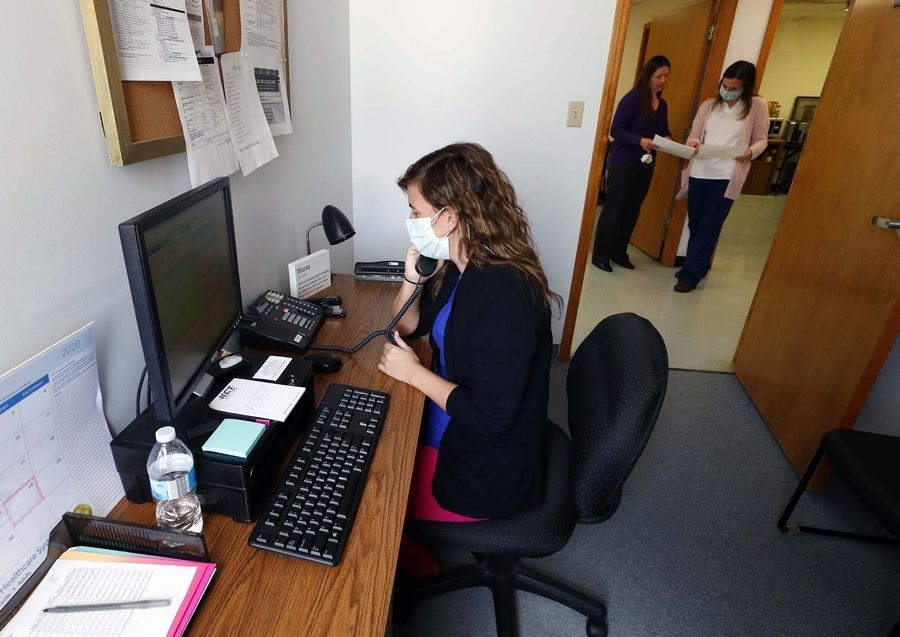 Nicole Zagozdon, a registered nurse, demonstrates how clinicians at the Ecker Center for Mental Health in Elgin are continuing to help clients with increased isolation due to the coronavirus pandemic.
