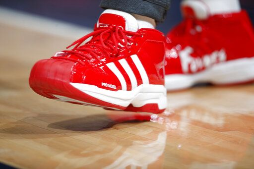 FILE - In this file photo dated Wednesday, Dec. 25, 2019, New Orleans Pelicans forward Derrick Favors wears Christmas-themed Adidas Pro Model Superstars shoes in the first half of an NBA basketball game Wednesday, Dec. 25, 2019, in Denver, USA.  Sports apparel and shoe company Adidas said Tuesday April 14, 2020, it has been approved by the German government for a 3 billion-euro ( US dollars 3.3 billion) emergency loan to help the company get through a period of lost business due to the COVID-19 coronavirus outbreak.