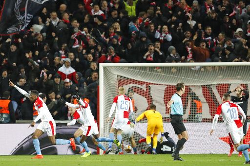 In this file photo taken on Thursday, March 14, 2019, Slavia's Ibrahim-Benjamin Traore, left, celebrates scoring the decisive goal during their Europa League Round of 16 second leg soccer match between Slavia Praha and Sevilla in Prague, Czech Republic. The top two soccer leagues in the Czech Republic are set to restart on May 25, 2020, as the country's has been easing its restrictive measures adopted by the government to contain the coronavirus pandemic.