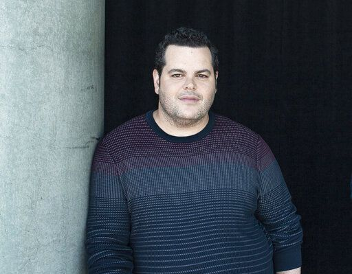 "FILE - This Nov. 9, 2019 file photo shows actor Josh Gad during a portrait session at The W Hotel in Los Angeles. Gad hosted reunion with the cast and creatives behind the 1985 film ""Goonies"" which also served as a fundraiser for a fundraiser for those affected by the pandemic.(Photo by Rebecca Cabage/Invision/AP, File)"