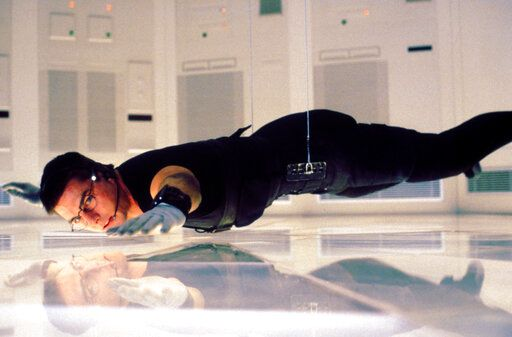 "This mage released by CBS Entertainment, Tom Cruise appears in a scene from the first installment of the popular ""Mission: Impossible"" franchise.  Throughout May, CBS is bringing back its Sunday movie showcase, a longtime network fixture that ended nearly 14 years ago. The film airs on Sunday, May 17. (CBS Entertainment via AP)"