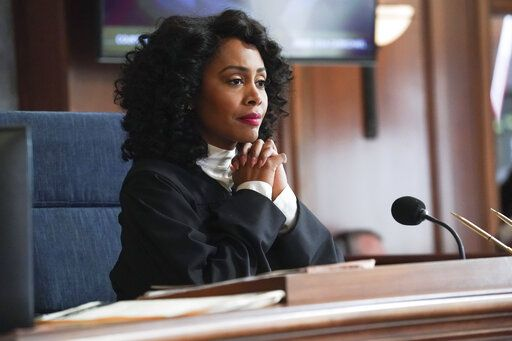 "This image released by CBS shows Simone Missick in a scene from ""All Rise."" The legal drama has become the first U.S. scripted television series to adapt the coronavirus pandemic by producing an episode remotely. It enlisted its stars to work from home on their own makeup, set design and lighting.  The season finale airs Monday night, May 4, 2020 on CBS and finds Missick's Judge Lola Carmichael presiding over a Los Angeles Superior Court bench trial via video conference.  (Monty Brinton/CBS via AP)"