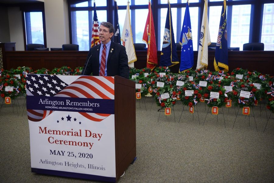 Arlington Heights Mayor Tom Hayes spoke Thursday during a Memorial Day ceremony that was recorded in the village hall boardroom for future broadcast.
