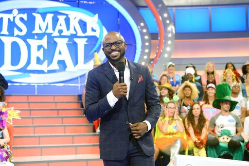 "This image released by CBS Entertainment shows Wayne Brady, host of the daytime game show ""Let's Make a Deal."" The CBS daytime game show that usually has a studio audience in zany costumes is asking front-line workers to submit a video audition for an upcoming special online edition of the show. (Bonnie Osbourne/CBS via AP)"