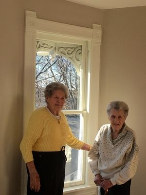 Terry Donahue, right, and her longtime partner, Pat Henschel, lived for decades in a historic St. Charles house. After neighbors bought and refurbished it, they returned for a visit.