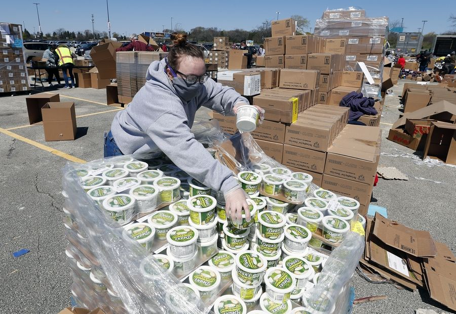 Emma Chvatal of Lombard sorts and prepares food for packing. A collaboration between the Six Flags Great America theme park, the village of Gurnee and the Northern Illinois Food Bank gave away free food for 3,000 families in the theme park parking lot in Gurnee Saturday.