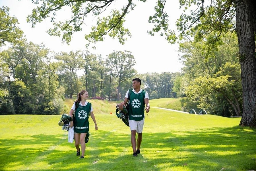 Caddies Jaclyn Prucha of Chicago and Donavan Bird of Elgin work in July 2017 at Olympia Fields Country Club.
