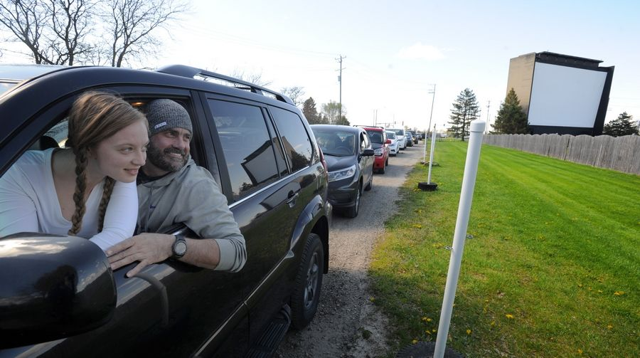 Lindsay Gerhardt, of Roselle and boyfriend Geoff Young of Volo, look out at the McHenry Outdoor Theater and can't wait to be there for opening night to see the Flintstones and Jurassic Park at the outdoor drive-in, the last surviving Chicago-area one of its kind.