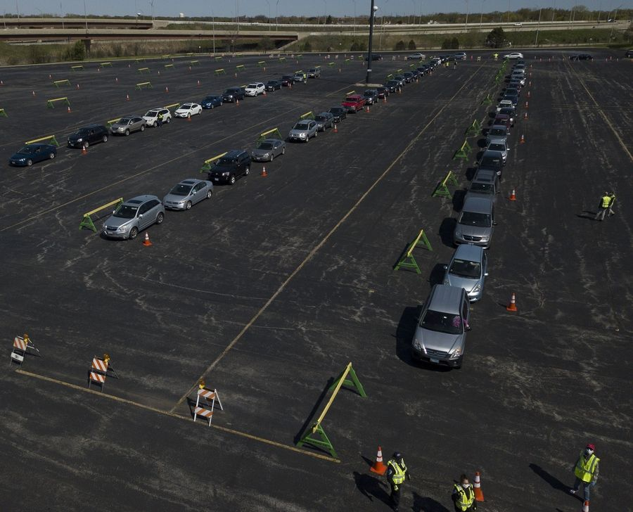 Hundreds of cars filled the parking lot across from Boomers Stadium in Schaumburg to collect their five masks out of 70,000 that were being passed out courtesy of the Village of Schaumburg.