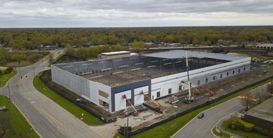 Construction continued Monday on Amazon's 162,000-square-foot distribution facility off Hicks Road just west of Route 53 in Palatine. The building could be ready as soon as October.
