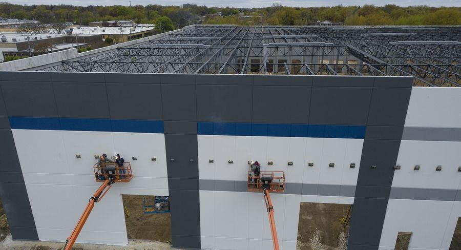 Construction continued Monday on Amazon's distribution facility off Hicks Road in Palatine.