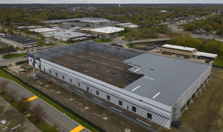 Amazon will move into a 162,000-square-foot warehouse and distribution facility in Palatine. Work on the building continued Monday.