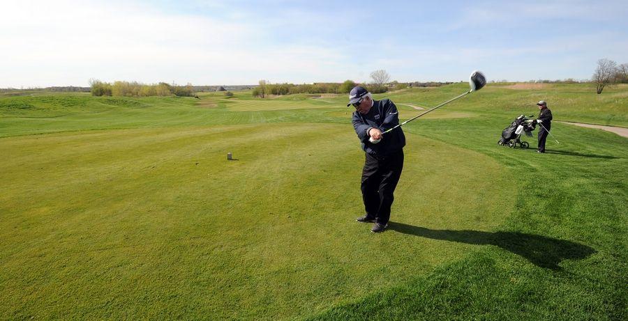 "Jim Miller of Geneva golfed last week at The Highlands of Elgin golf course. Elgin implemented resident and senior discounts there and at Wing Park golf course after ""dynamic pricing"" caused prices to nearly double after courses were allowed to reopen May 1."