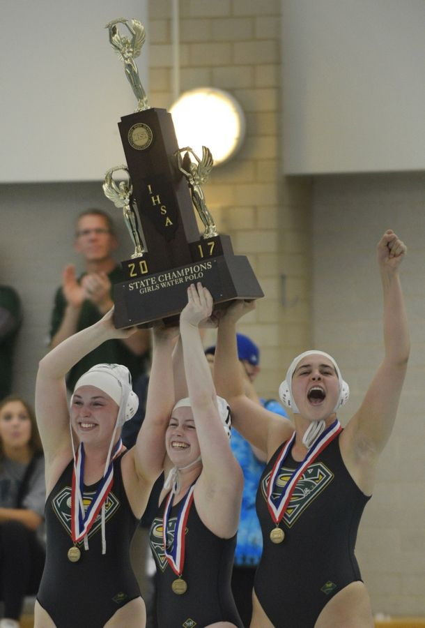 Stevenson captains, from left, Julia Nicholson, Fiona Gaffney and Claire Haas hoist the 2017 state championship trophy, the first of the Patriots' three titles in a row.