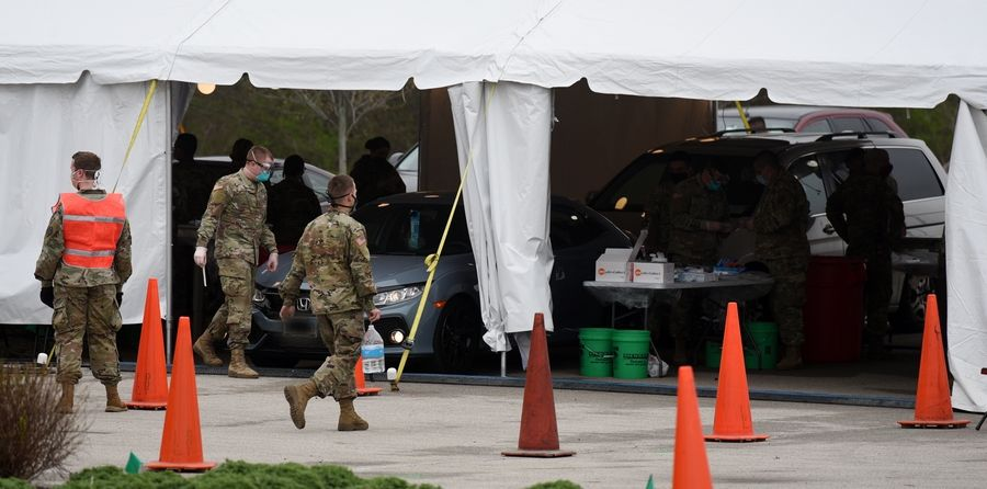 The National Guard runs a drive-thru COVID-19 testing site at Chicago Prime Outlets in Aurora.