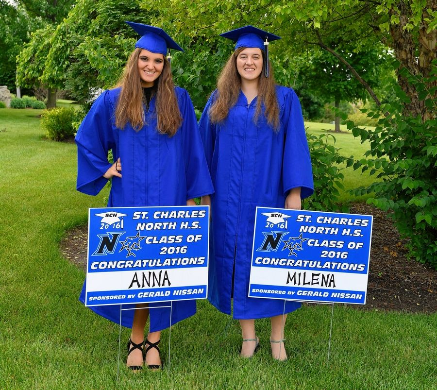 For five years, entities within Gerald Auto Group have sponsored senior signs for St. Charles North High School. This year, placing signs in seniors' yards is one tradition that unaffected by the COVID-19 crisis. Pictured are Anna Sangali of Italy and Milena Petrovic of Montenegro in 2016, exchange students who stayed with sign designer Tom Mullallay.