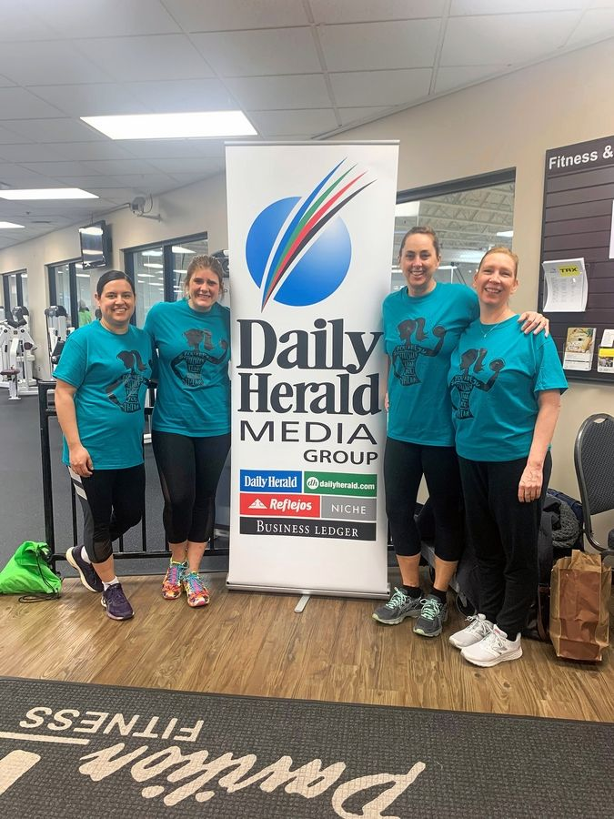 "Schaumburg Park District's ""Schaumburg Shredders"" had a final group photo before quarantine at the Indoor 5K at Elk Grove Pavilion Fitness. From left, Eliana Lucena, Anna Schuld, Stacy Johnson and Karlin Soelberg."