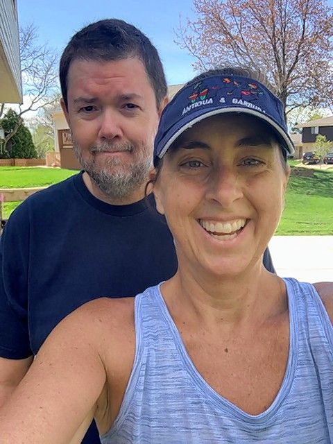 "Schaumburg Park District's Stacy Johnson of ""Schaumburg Shredders"" is shown with her husband, Glenn, who is dragged outside daily for a walk."