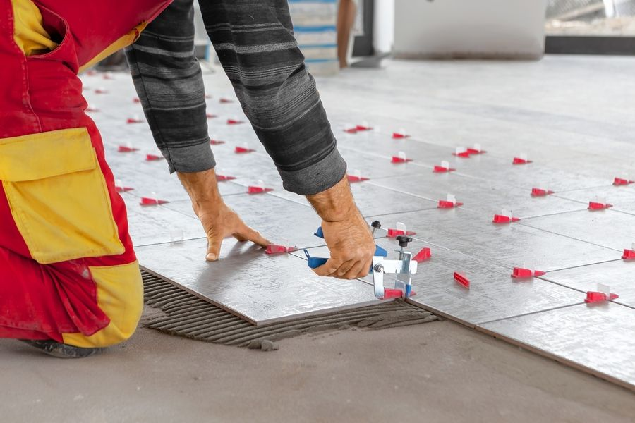 Because of its ability to withstand water, flooring experts recommend tile for kitchens, bathrooms and entryways.