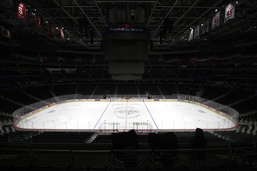 FILE - This is a March 12, 2020, file photo showing Capital One Arena, home of the Washington Capitals NHL hockey club in Washington. Get used to the concept of pods and pucks if the NHL is going to have any chance of completing its season, with the most likely scenarios calling for games in empty, air-conditioned arenas during the dog days of summer.