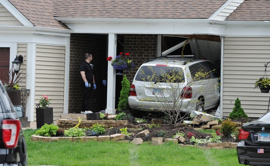 Police are searching for the driver of an SUV that may have struck and killed a man Wednesday morning before crashing into a home on the 700 block of Equestrian Drive in Wheeling.