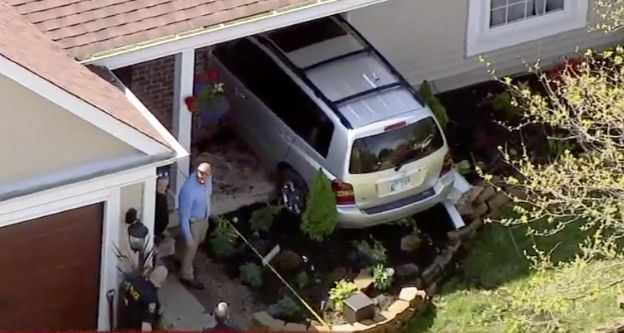 An aerial image shows the SUV that crashed into a Wheeling home Wednesday morning. A man was found dead at the scene and a manhunt was underway for the vehicle's driver.