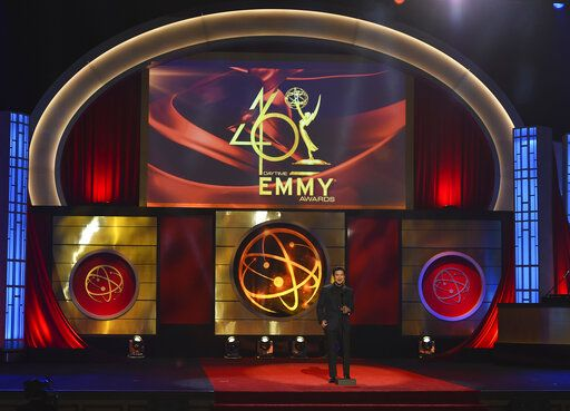 FILE - This May 5, 2019 file photo shows host Mario Lopez on stage at the 46th annual Daytime Emmy Awards in Pasadena, Calif. The Daytime Emmy Awards are skipping a theater ceremony because of the coronavirus but the honors will be presented on a TV broadcast on June 26. Nominations for the 47th annual Daytime Emmys will be announced Thursday on CBS' 'œThe Talk,'� with categories including best drama series, talk show and game show. The TV academy that organizes the daytime awards had announced it wouldn't hold the traditional theater ceremony out of pandemic safety concerns. (Photo by Chris Pizzello/Invision/AP, File)
