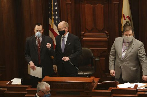 New Illinois Senate President Don Harmon, D-Oak Park, center, and others wear masks amid the coronavirus pandemic during session at the State Capitol, Wednesday, May 20, 2020, in Springfield, Ill. (Erin Hooley/Chicago Tribune via AP, Pool)