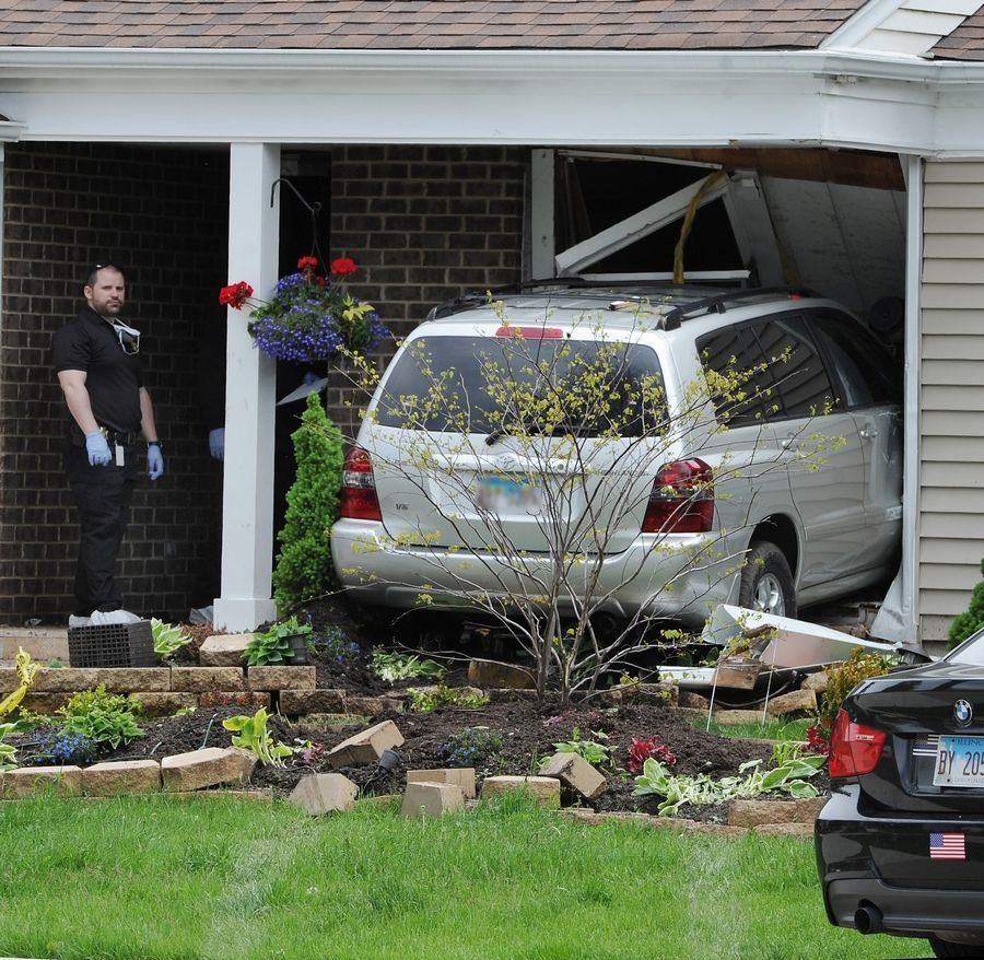 Wheeling police believe the driver of this SUV intentionally hit and killed another man Wednesday morning in Wheeling before crashing through the front entryway of a home on the 700 block of Equestrian Drive.