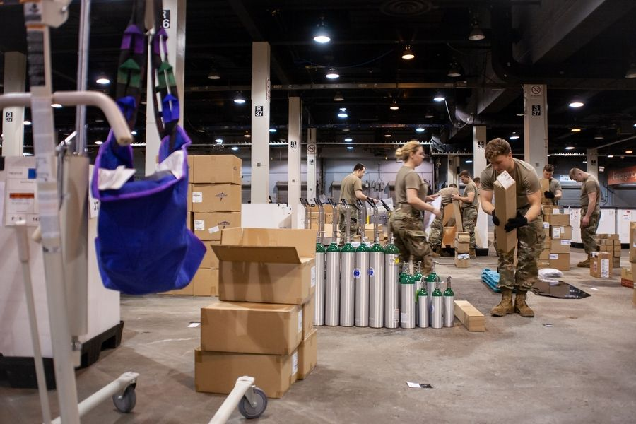 Members of the Illinois Air National Guard assemble medical equipment at the McCormick Place Convention Center in response to the COVID-19 pandemic.
