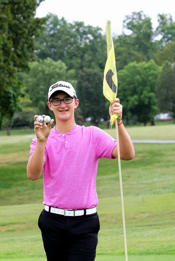 Cy Norman from Benton poses with the two hole-in-one balls from Monday's round at Benton County Club. Norman aced the par-3 No 4 and No. 7, giving him a total for four aces in his lifetime. Norman is 15 and will be a sophomore at Benton High School.