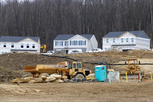 In this March 18, 2020 photo, Construction continues at a housing plan in Zelienople, Pa.,  The housing market has stalled, but homebuilder stocks are up sharply amid signs that sales are starting to improve. Still, the outlook for a housing market recovery remains cloudy, given uncertainty over the pandemic's impact.