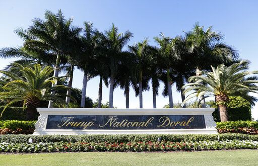 In this Nov. 20, 2019 photo, the entrance to the Trump National Doral resort is shown in Doral, Fla. The Trump golf resort in South Florida where President Donald Trump initially wanted to host this year's Group of Seven summit has temporarily laid off over 500 workers.
