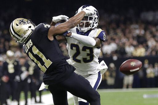 FILE - In this Jan. 20, 2019, file photo, Los Angeles Rams' Nickell Robey-Coleman breaks up a pass intended for New Orleans Saints' Tommylee Lewis during the second half of the NFL football NFC championship game in New Orleans. The NFL is considering adding a 'œbooth umpire'� and a senior technology advisor to the referee to assist the officiating crew. NFL clubs received a list of potential rules changes on Thursday, May 21, 2020.