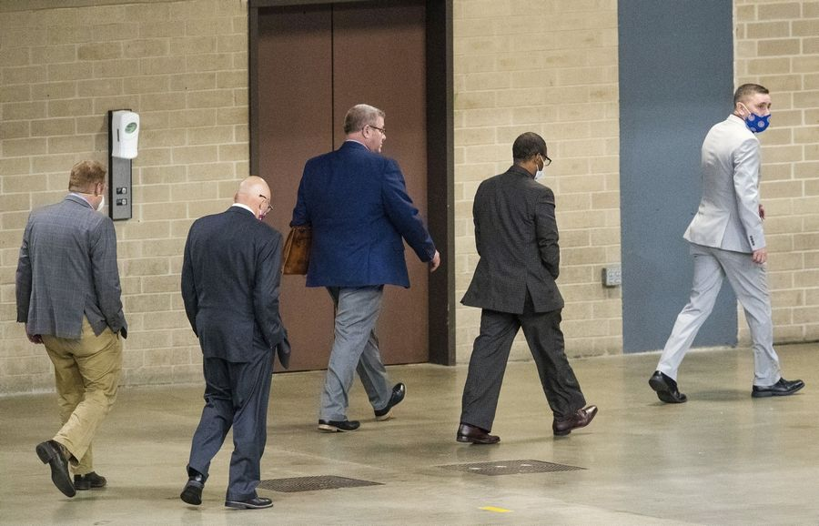 Illinois state Rep. Darren Bailey is escorted from the Bank of Springfield Center Wednesday after the Illinois House voted 81-27 to remove him from the floor for not wearing a face mask. He returned Thursday wearing a mask.