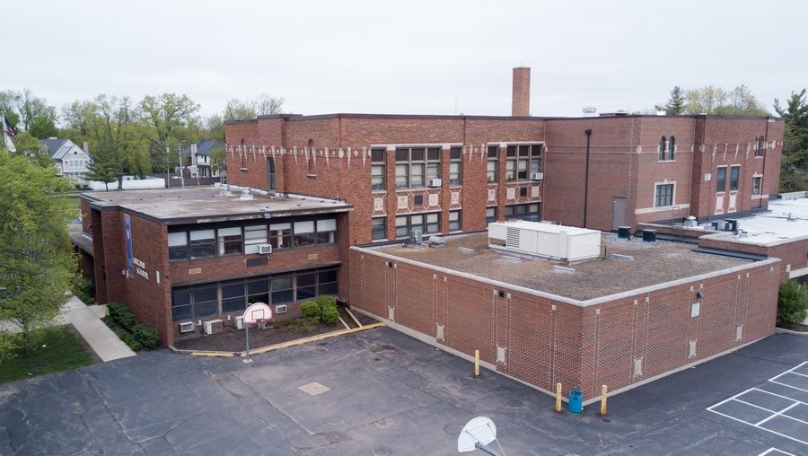 A teacher at Lincoln Elementary School is suing Elmhurst Unit District 205, saying officials retaliated when she complained that mold at the school was harming her health.