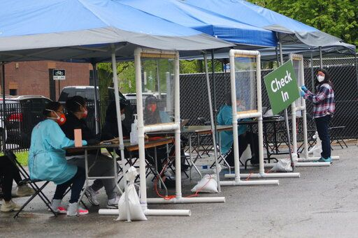 In this May 14, 2020 photo, a new testing site opened in the Little Village neighborhood of Chicago after initial reports that testing was lacking in the area. Chicago's Little Village neighborhood is known as the heart of Mexican culture in the city. It's also located in the zip code area with one of the highest rates of positive coronavirus cases in the city. Across the country, states reporting racial data indicate similar trends, with overwhelmingly high rates of infection within the Latino population.