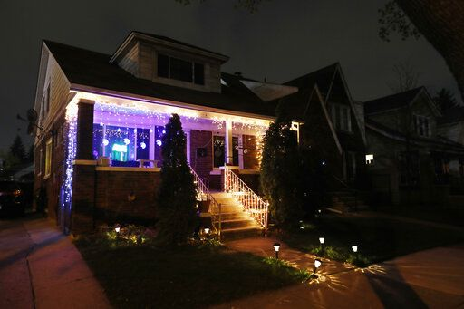 FILE - In a file photo from Tuesday, April 28, 2020, Ramadan lights are displayed on a house in Dearborn, Mich. The Muslim community in Dearborn is starting a new tradition this year. The community is hosting a Ramadan lights competition in hopes of spreading joy and bringing back some of the holiday spirit during the coronavirus pandemic.