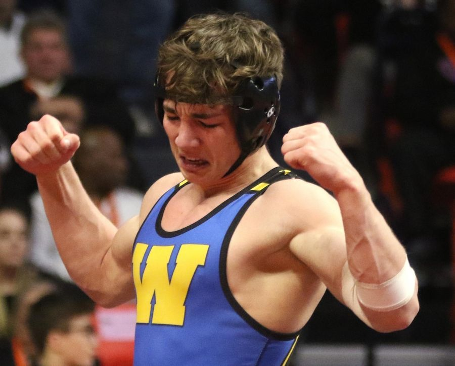 Warren's Joel Vandervere celebrates a win against Dekalb's Fabian Lopez in the title bout at 138 pounds in Class 3A of the State Final Tournament in Individual Wrestling at State Farm Center on the campus of the University of Illinois in Champaign.
